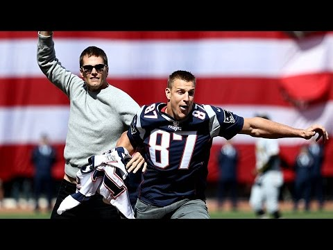 Rob Gronkowski  steals  Tom Brady s jersey at Red Sox opening day ... 325a54309