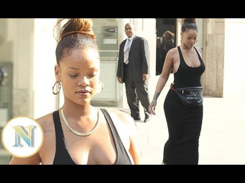 b45b9f6b1f3 Rihanna goes bratess beneath VERY revealing tank dress and Gucci bag before  Fenty NYFW Show